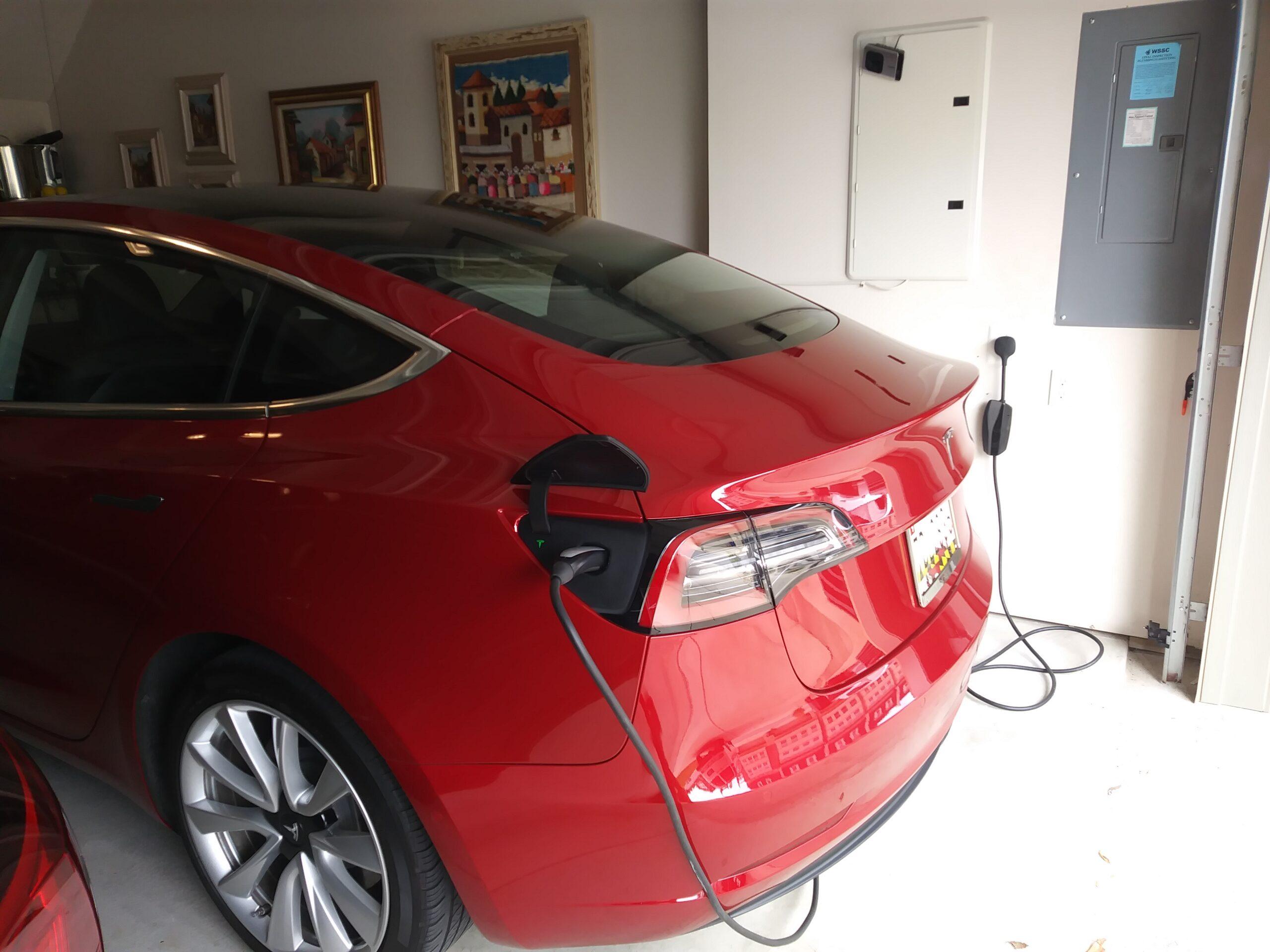 Telsa Nema 14-50 under panel in garage.